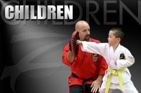 child learning martial arts