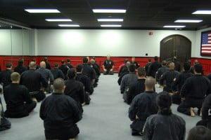 Martial Arts Black Belts Getting Ready for Their Lesson